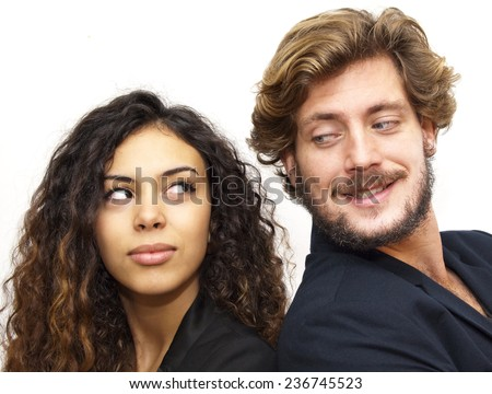 Beautiful portrait of a loving couple are back to back on white background - stock photo