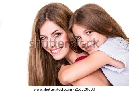 Beautiful portrait of hugging mother and daughter - stock photo
