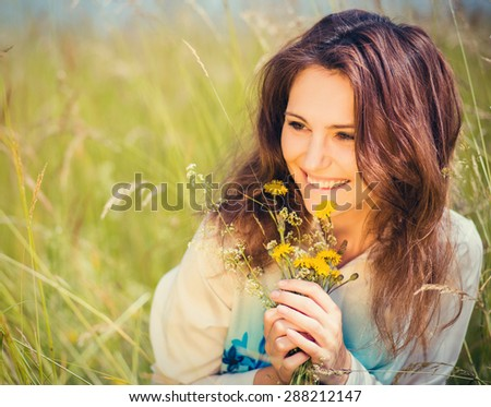 beautiful portrait of nice woman in a field - stock photo