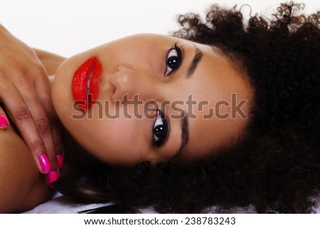 Beautiful Portrait Of Reclining African American Woman - stock photo