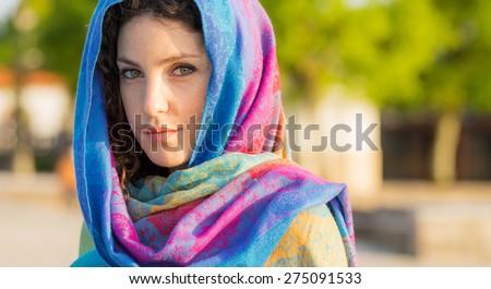 Beautiful Portuguese Woman at Sunset, Arabic Style - stock photo
