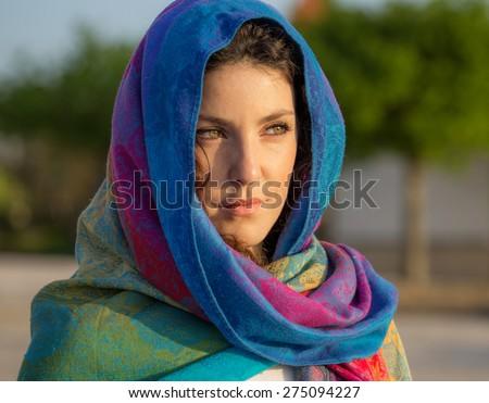 Beautiful Portuguese Woman Portrait at Sunset, Arabic Style - stock photo