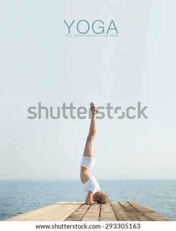 Beautiful positiveblond girl practicing yoga at seashore and meditating  - stock photo