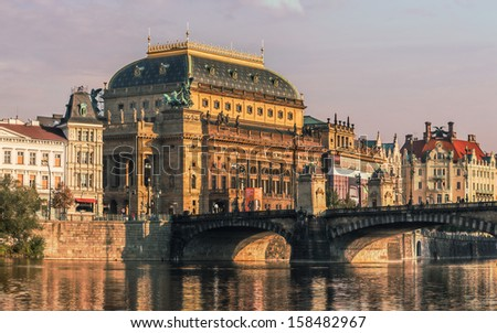 Beautiful Prague National Theatre along the river Vltava - stock photo