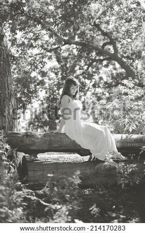 Beautiful pregnant woman in fairy forest - stock photo
