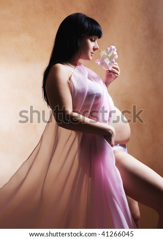 beautiful pregnant woman with lily. - stock photo