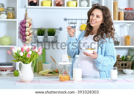 beautiful pregnant woman with  milk - stock photo