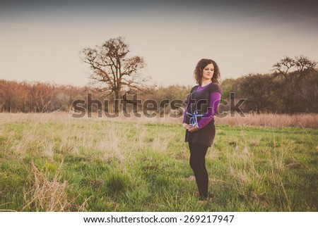 beautiful pregnant young woman outdoor - stock photo
