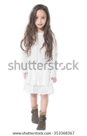 beautiful preschool girl standing on the white background - stock photo