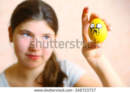 beautiful preteen girl pain easter egg - stock photo