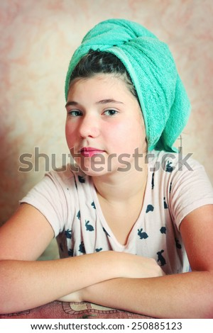 beautiful preteen girl with wet hair in towel after shower - stock ...