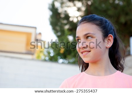 Beautiful preteen with blue eyes in the garden - stock photo