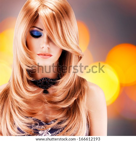 Beautiful pretty woman with long red hairs. Portrait  of young fashion model with blue eye makeup - stock photo