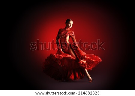 Beautiful professional dancer performs latino dance. Passion and expression. - stock photo