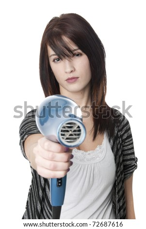 Beautiful professional hair stylist holding blow dryer - stock photo