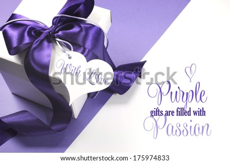 Beautiful purple and white gift box with sample text, Purple Gifts Are Filled with Passion, or copy space for your text here. - stock photo