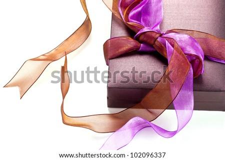 Beautiful purple gift box over white background - stock photo