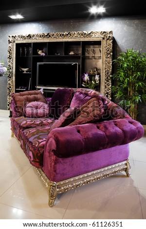 Beautiful purple sofa in a modern apartment - stock photo