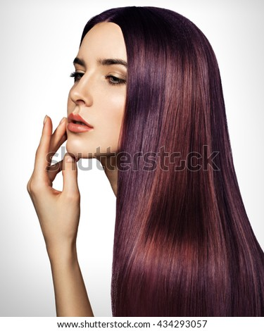 Beautiful purple woman with long, healthy, straight and shiny hair. Hairstyle loose hair. Model girl with luxurious smooth straight hair. Hair cosmetics. White background. - stock photo