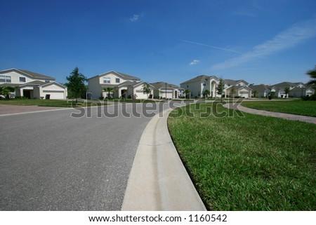 Beautiful quiet neighborhood in the suburbs - stock photo
