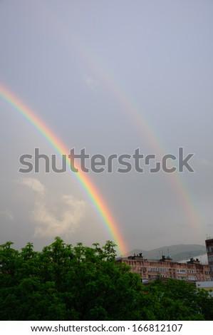 Beautiful rainbow after the rain - stock photo