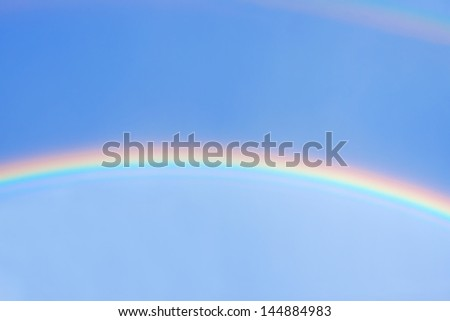 beautiful rainbow in blue sky after the rain - stock photo