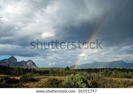 Beautiful Rainbow over Mountain - stock photo