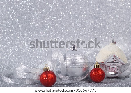 Beautiful red and silver christmas balls on glitter background with copy space - stock photo