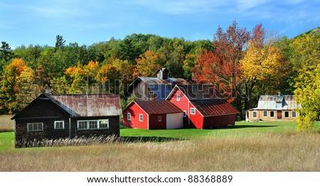 Beautiful Red Barns in Autumn, Sleeping Bear Dunes National Lakeshore Michigan,USA - stock photo