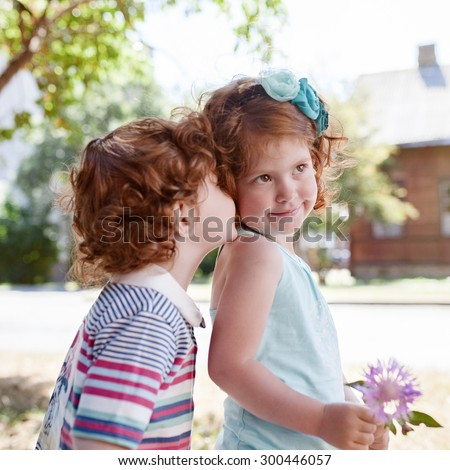 beautiful red children walk along a sunny day in the summer - stock photo