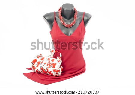 Beautiful red dress on mannequin with matching accessories. Elegant dress on tailor's dummy with matching colorful purse and red necklace - stock photo