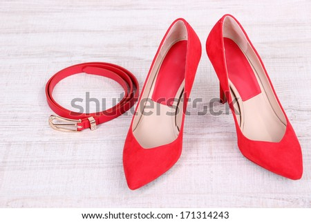 Beautiful red female shoes and  belt  - stock photo