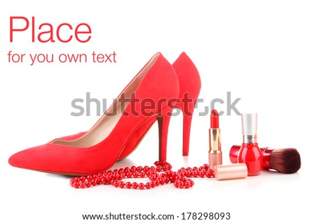 Beautiful red female shoes and cosmetics, isolated on white - stock photo