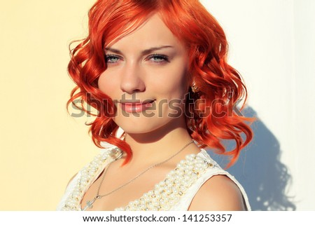 beautiful red-haired girl on a walk - stock photo