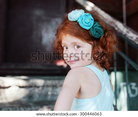beautiful red-haired girl with beautiful eyes in a turquoise platitse - stock photo