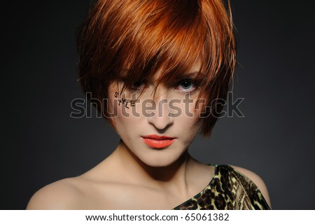 Beautiful red heaired woman portrait with fashion hairstyle and creative trendy make-up - stock photo
