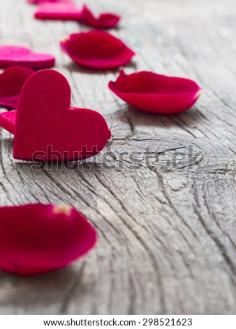 beautiful red hearts with rose petals on the wooden background, love concept - stock photo