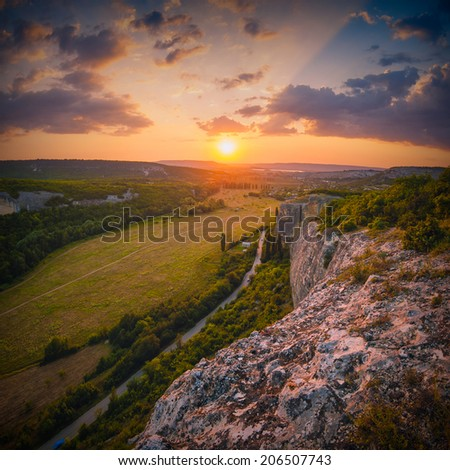 Beautiful red sunrise above the Crimea mountain valley - stock photo