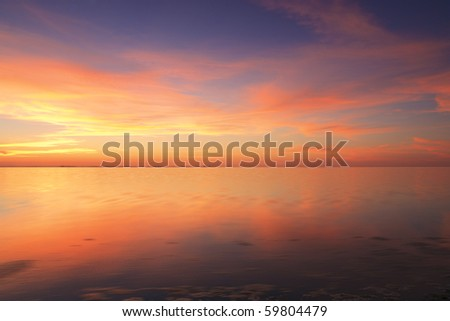 Beautiful red sunset over the ocean - stock photo