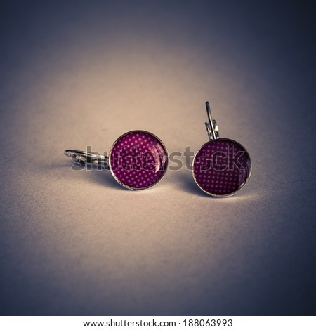 Beautiful red woman earrings with white dots on white background - stock photo