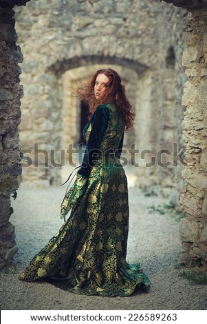 Beautiful redhead girl wearing a medieval costume - stock photo