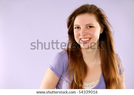 beautiful redhead girl with freckles in studio - stock photo