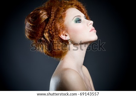 Beautiful redhead woman's profile. Perfect classy hair style and makeup. - stock photo