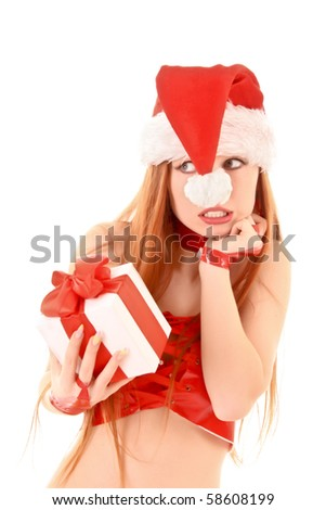 Beautiful redhead woman with Christmas present in hands isolated on white. - stock photo