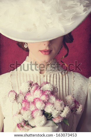 Beautiful redhead women with bouquet - stock photo