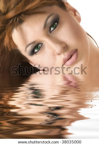 Beautiful redheaded woman reflected in water effect - stock photo