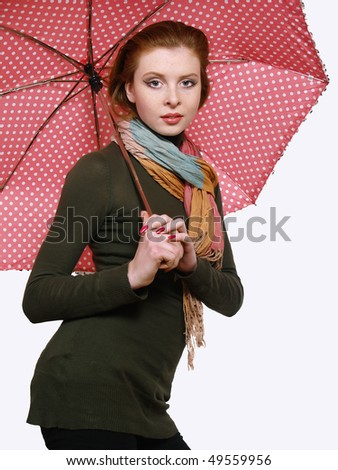 Beautiful redheaded young women with pink umbrella, isolated - stock photo