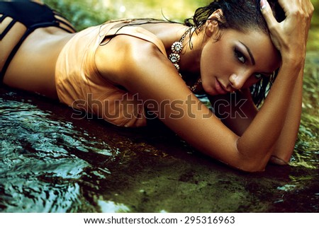 Beautiful refined girl with a beautiful figure - stock photo