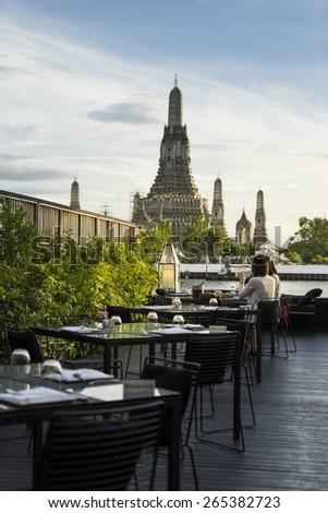beautiful restaurant to dinner and see wat arun (temple of dawn) bangkok thailand - stock photo