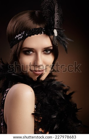 Beautiful retro woman in 20s style party outfit - Portrait of a flapper girl   - stock photo